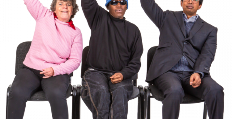 Three people sitting on a chair with one arm in the air
