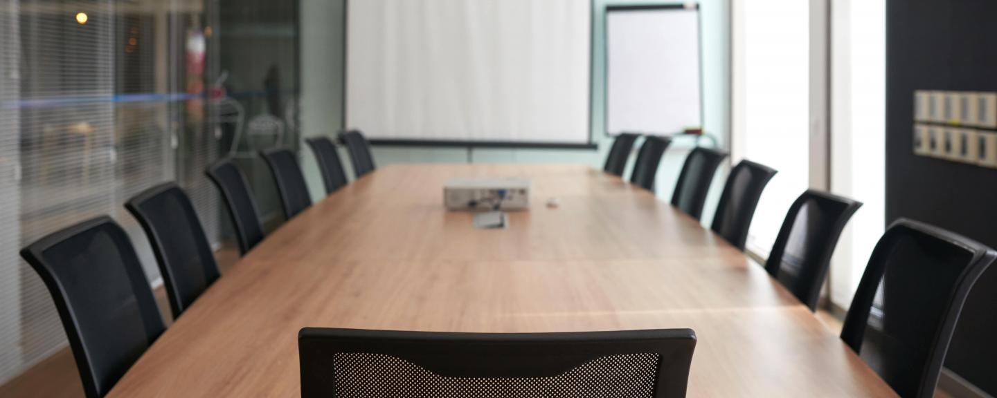 Meeting room with a table and chairs