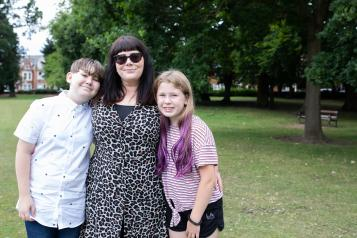 A mother with her son and daughter in a park