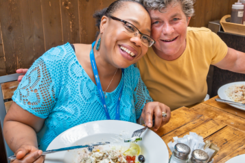 Two people sitting in a cafe eating a meal