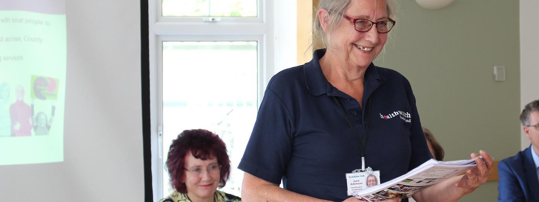 Healthwatch volunteer speaking at meeting