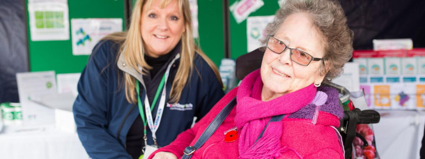 Lady in a wheelchair at Healthwatch event