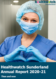 Covid nurse wearing scrubs looking at the camera